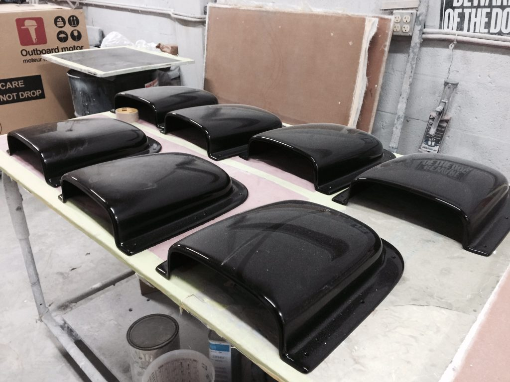 Fiberglass air scoops, soon to be mounted on the engine hatches, were pulled from tooling created by hand based on the shape of the originals in old photographs.
