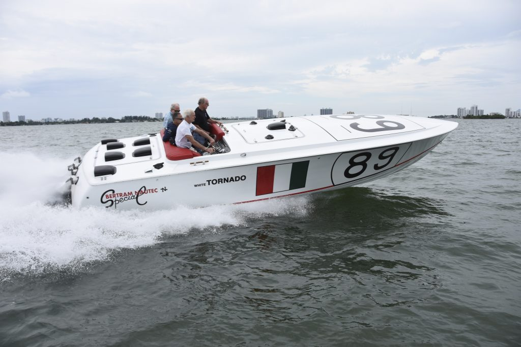 Sam James, who ran the Bertram racing team in the late 1960s and early 1970s, takes the helm of White Tornado during sea trials off Miami, Florida, last spring.