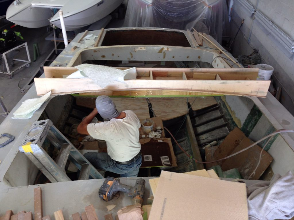 In Guardado's shop, a crew member makes a mold to copy the camber of the deck, the first step in replicating an original part that had been removed by a previous owner who wanted access to the forward area of the hull.
