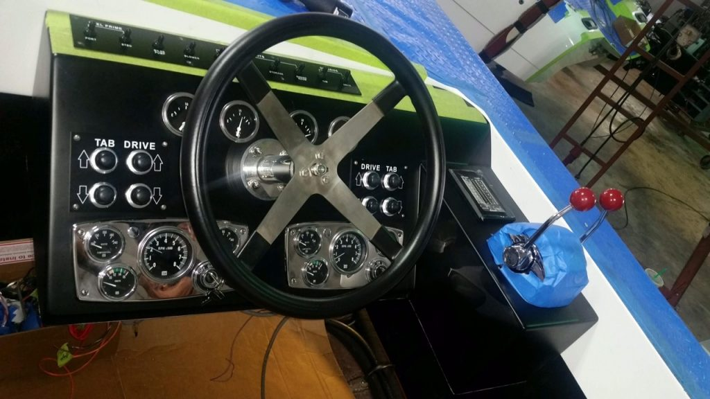 The dashboard with new analog gauges installed; TNT Custom Marine had to employ special software to translate the digital signals from the engine. Note that in this photo the labels for the tabs and drives were erroneously placed; they were later corrected.