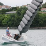 sailing shot of boat with inflated wing sail