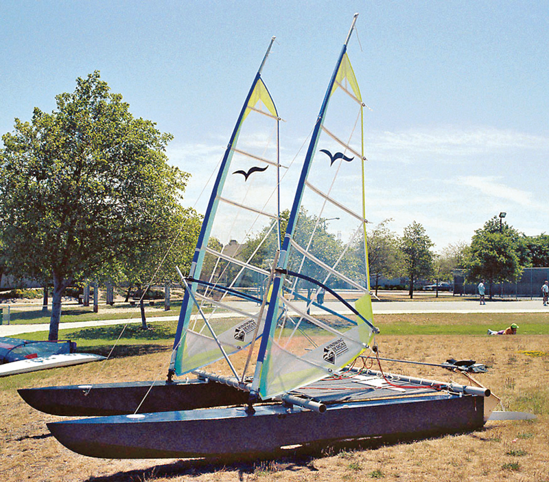 Alan Adler's prototype 14' (4.3m) stepped-hull sailing cat on the beach